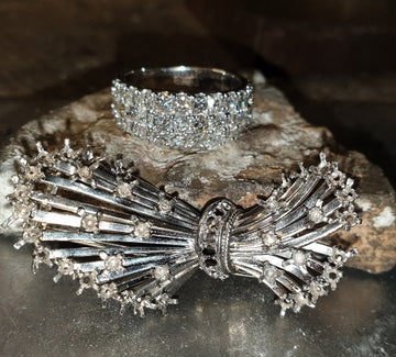 this shows a remodel job, it was a brooch which was diamond set,  now it is a stunning 3 row cocktail diamond ring