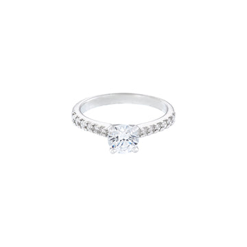 18ct white gold diamond solitaire ring with the round diamond set in 4 claws, there is also a claw set diamond band to add to the sparkle