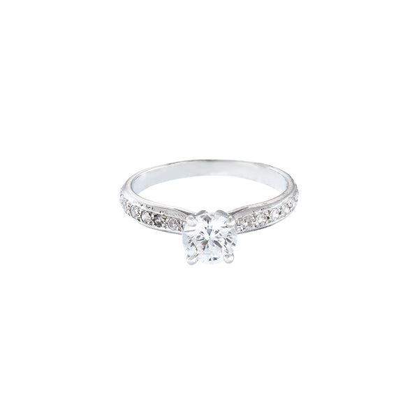 18ct white gold diamond solitaire engagement ring with round stone set in 4 claws and pave set shoulders