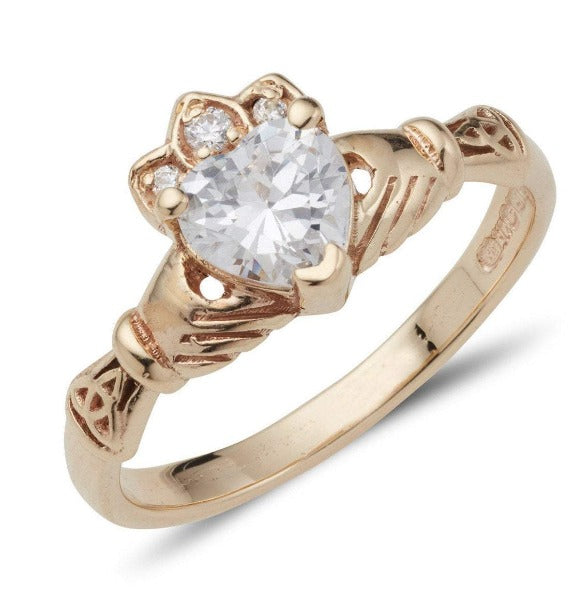 9ct yellow gold ladies birthstone claddagh ring with heart shaped stone in the centre and small round stones in the crown