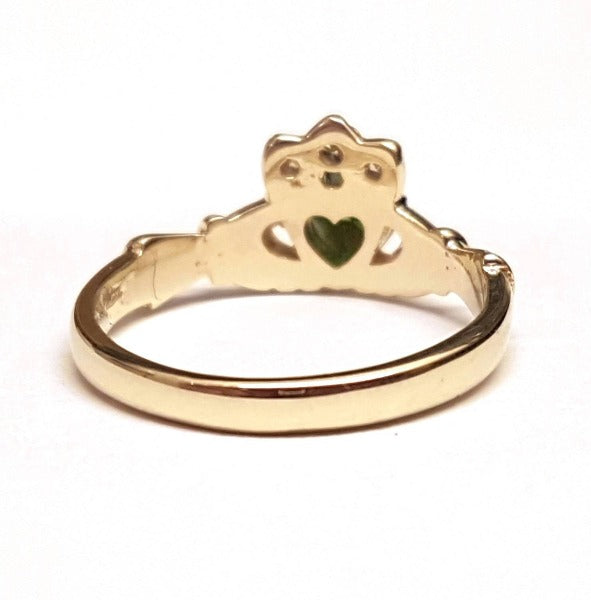 9ct yellow gold ladies birthstone claddagh ring with heart shaped stone in the centre and small round stones in the crown showing the back of the ring to show its solid