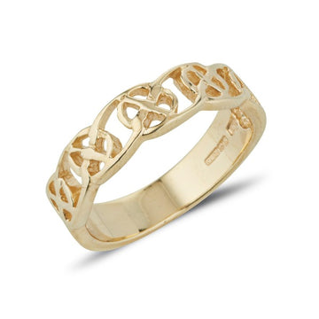yellow gold celtic design ring circle of life pattern, this is a 1/2 design 1/2 plain ring with a pierced out design