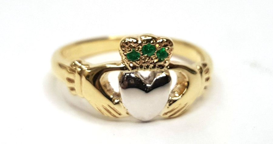 yellow gold ladies claddagh ring with white gold heart and 3 rubies in the crown