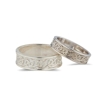 sterling silver celtic lovers knot matching his and hers wedding ring sets, the celtic design is in the middle of 2 raised edges
