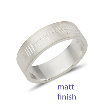 flat wedding ring with a matt finish and with Ogham personalised celtic script
