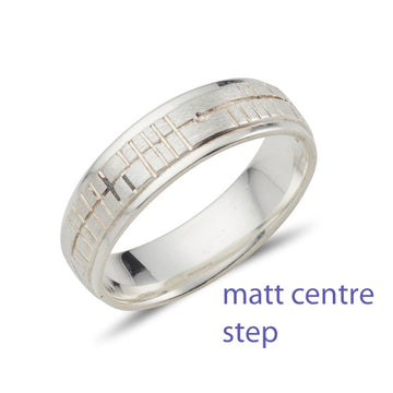 18ct white gold step wedding band, the centre is slightly raised, the centre has a matt finish which is engraved with celtic ogham script, the edges are polished