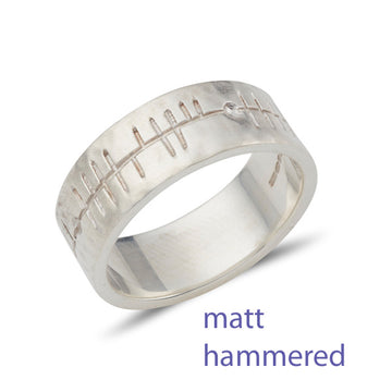 sterling silver flat band wit a matt hammered finish and inscribed with celtic Ogham