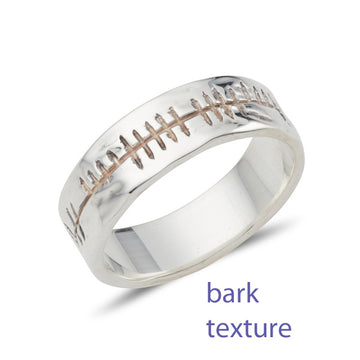 sterling silver flat band with a polished bark finish and inscribed with celtic Ogham