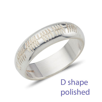18ct white gold d shape wedding ring, curved on the outside and flat on the inside, the ring is engraved with celtic Ogham personalised engraving