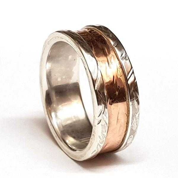 silver and gold wide wedding ring