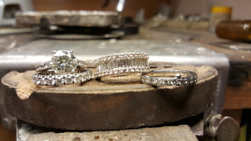 selection of white gold diamond rings after eing cleaned and rhodium plated