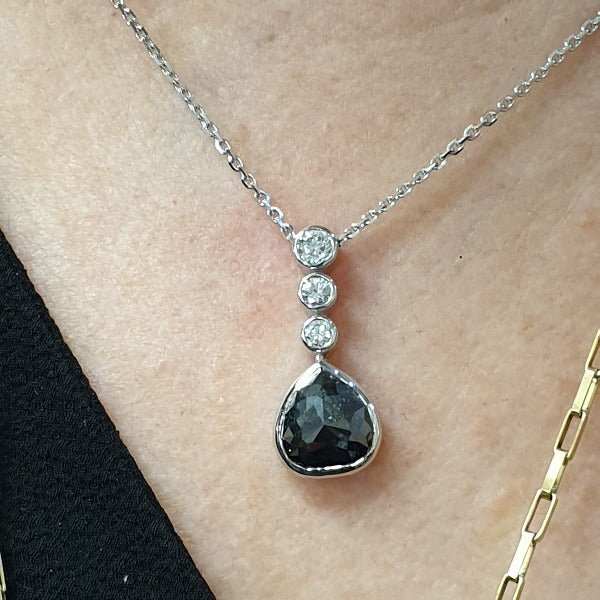 18ct white gold black diamond pendant bezel set briolette cut pear shaped, suspended from 3 small bezel set diamonds