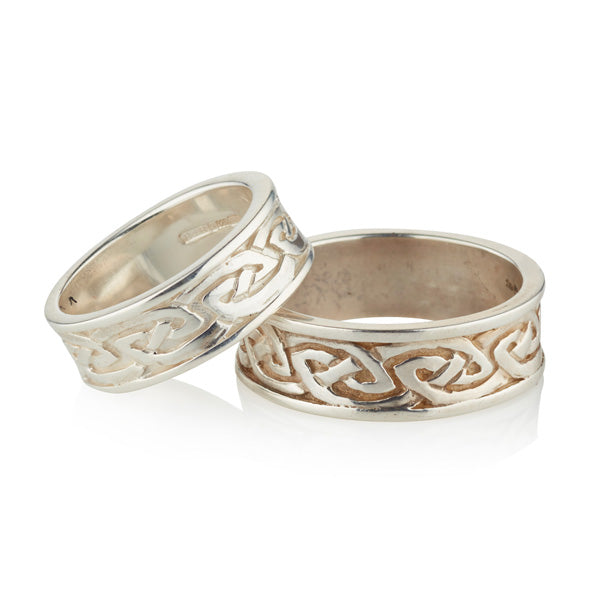 white gold matching his and her wide celtic wedding ring set.  the 2 celtic rings are solid and have plain straight rimms on each side