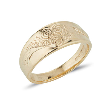 yellow gold celtic design ring with new grange spiral embossed on a tapered band