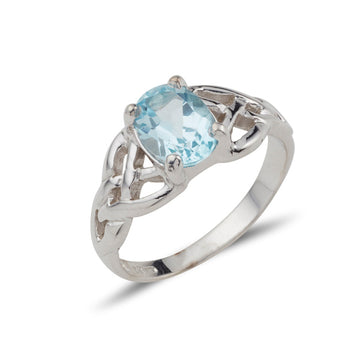 sterling silver twin celtic trinity triskle knot ring set with a 8mm * 6mm oval brilliant cut blue topaz within 4 claws