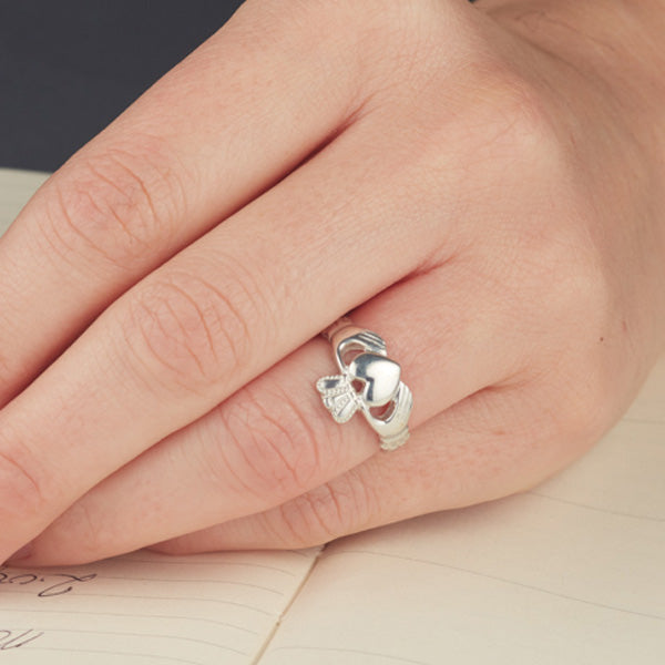 sterling silver claddagh ring classic style shown on a ladies finger