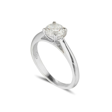 18ct white gold diamond solitaire engagement ring with tapered shoulders and a round diamond set in a 4 claw setting