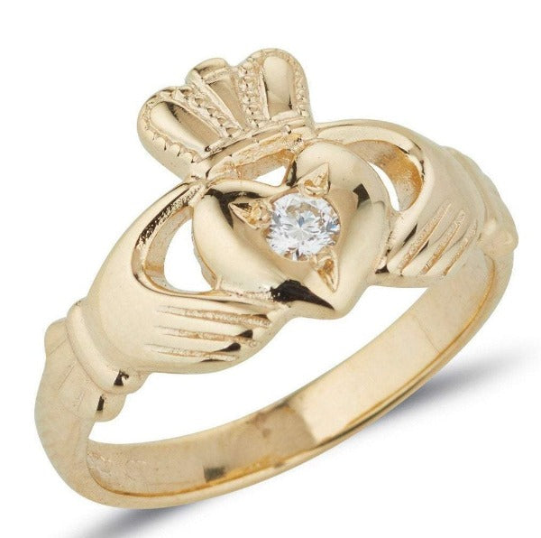 gold ladies claddagh ring with small diamond set into the middle of the heart