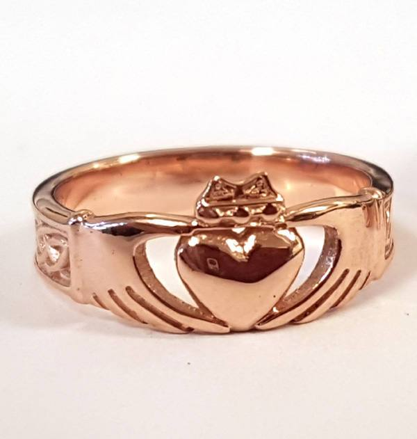 red gold modern claddagh ring with a plain band and the claddagh to the front