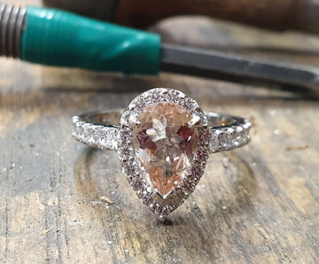 18ct white gold pear shaped cluster with centre stone morganite and round brilliant cut diamonds surrounding it