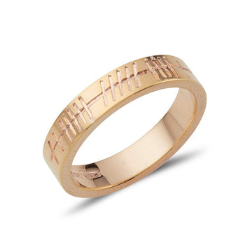 yellow gold narrow flat weddding band with personalised ogham inscription