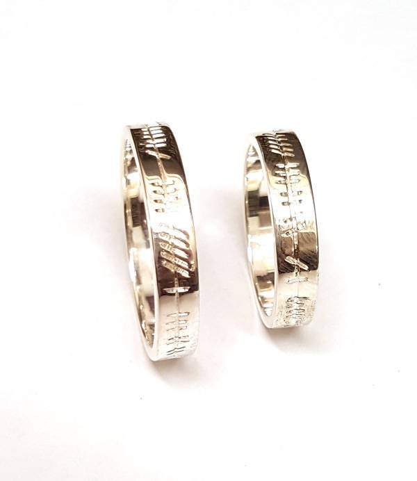 matching his and hers celtic ogham inscription wedding bands