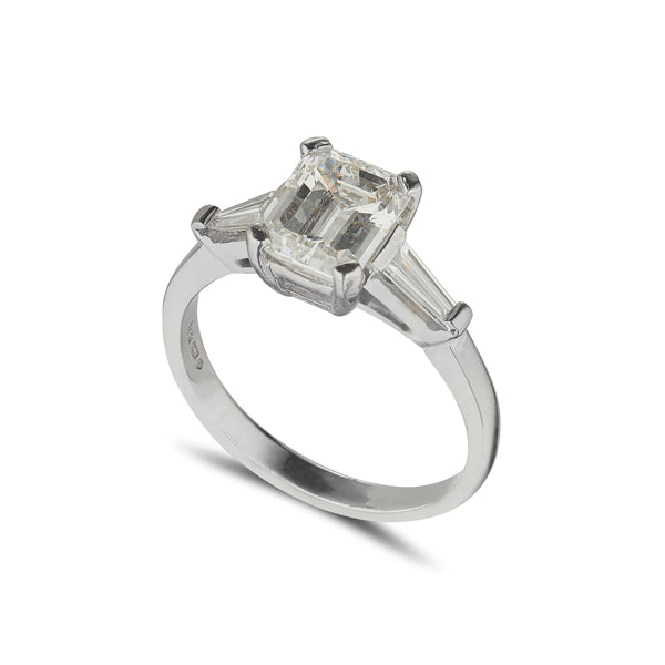 platinum diamond solitaire ring with 2 tappered baguette diamonds at the side