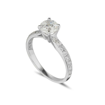 platinum diamond solitaire engagement ring with 4 claws and diamond set shoulders