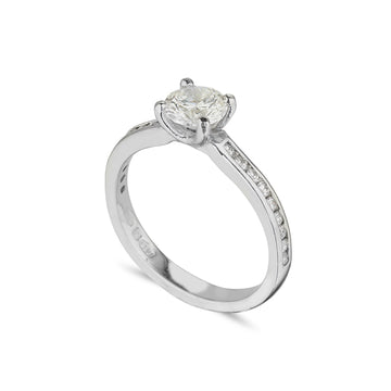 platinum diamond solitaire ring with channel set soulders