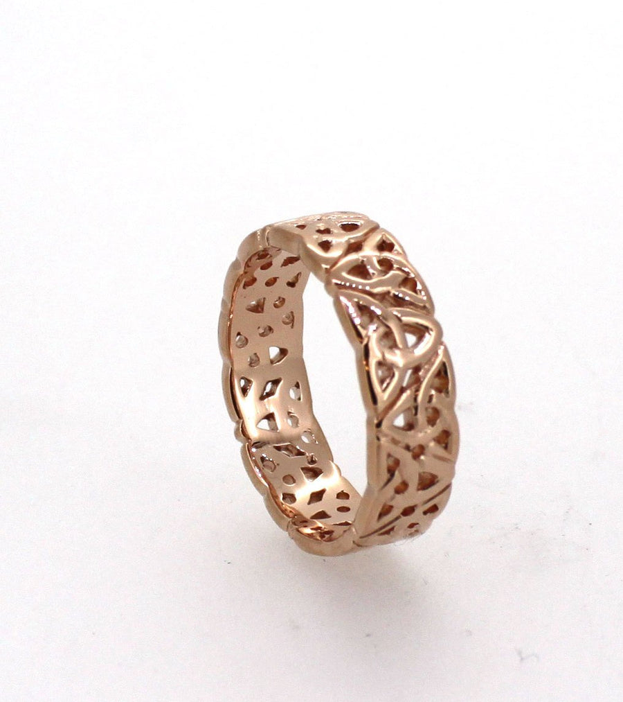 9ct rose gold celtic trinity knot ring,  the ring has celtic trinity knots alternating point up and point down the full way around the ring