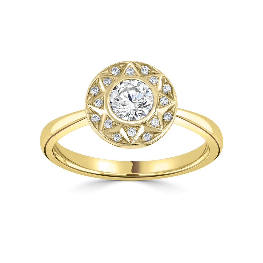 vintage style bezel set halo ring in yellow gold