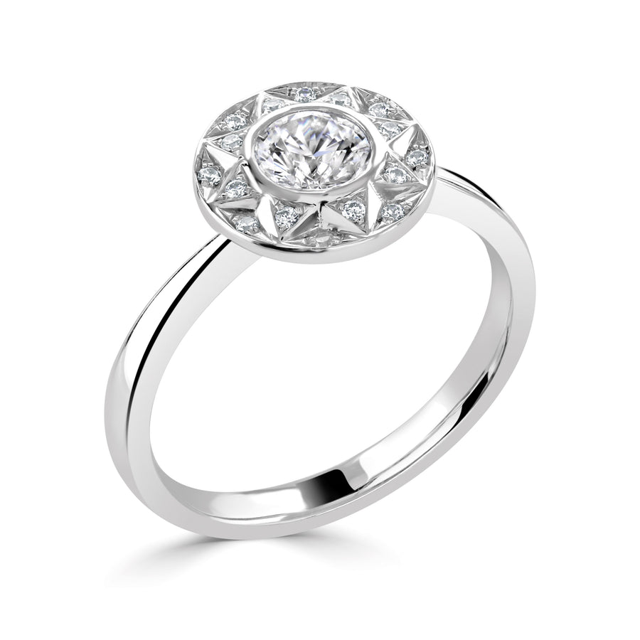 vintage style bezel set halo ring in white gold