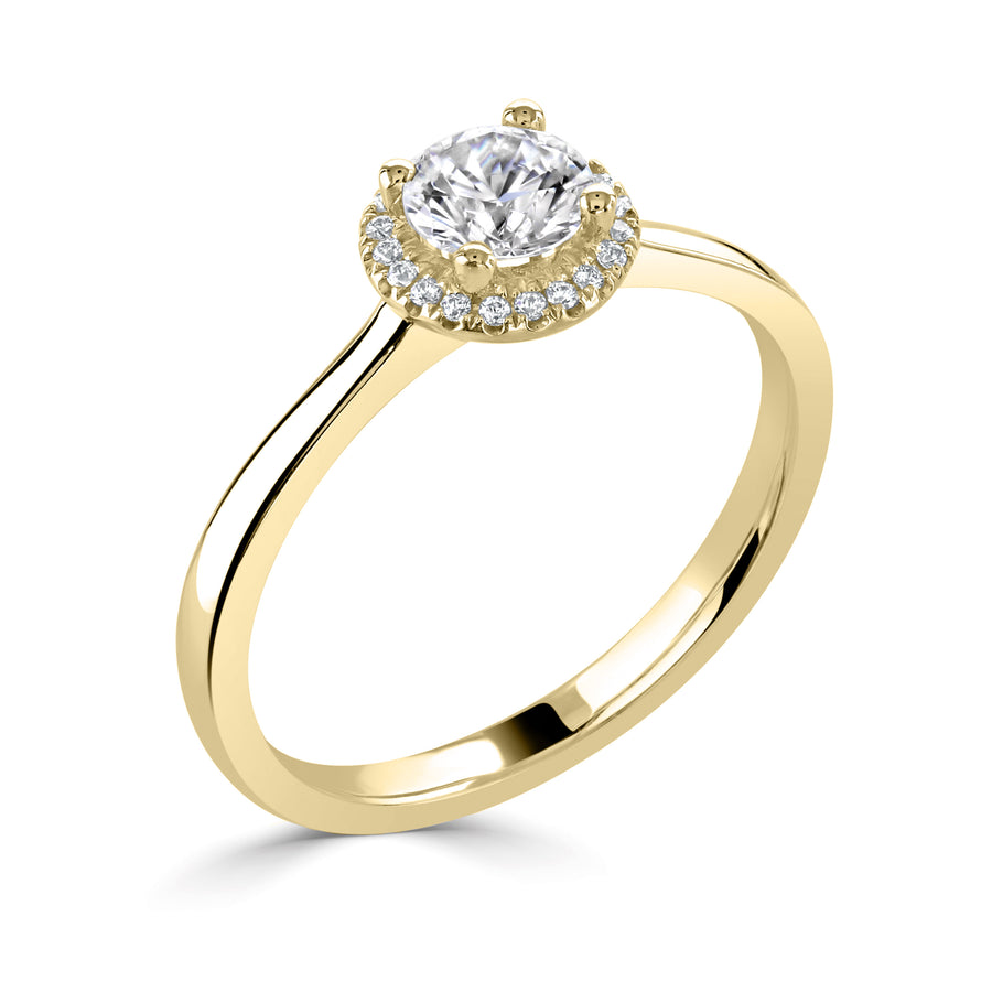 simple diamond round halo engagement ring in yellow gold