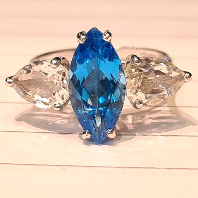 3 stone ring with a marquise blue tpaz and 2 pear shape aqua marine gemstones  ring