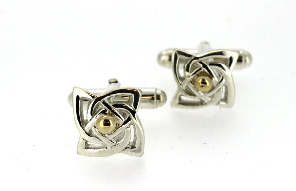 sterling silver celtic design cuff links with a curvey square shape and yellow gold detail in the centre,  the cufflink has a torpedo fitting