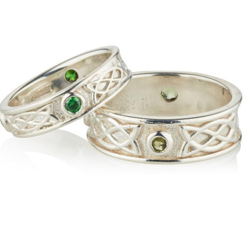 Sterling Silver celtic design matching his and hers rings, they are set with 3 green cubic zirconias in each ring, the 3 stones are rubover or bezel set at north east and west points of the ring, as shown on a ladies and gents hands