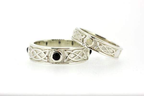 Sterling Silver celtic design matching his and hers rings, they are set with 3 onyx stones in the gents and 3 mother of pearls, the 3 stones are rubover or bezel set at north east and west points of the ring