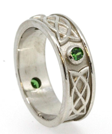 Sterling Silver celtic design ring , it is set with 3 green cubic zirconias, the 3 stones are rubover or bezel set at north east and west points of the ring