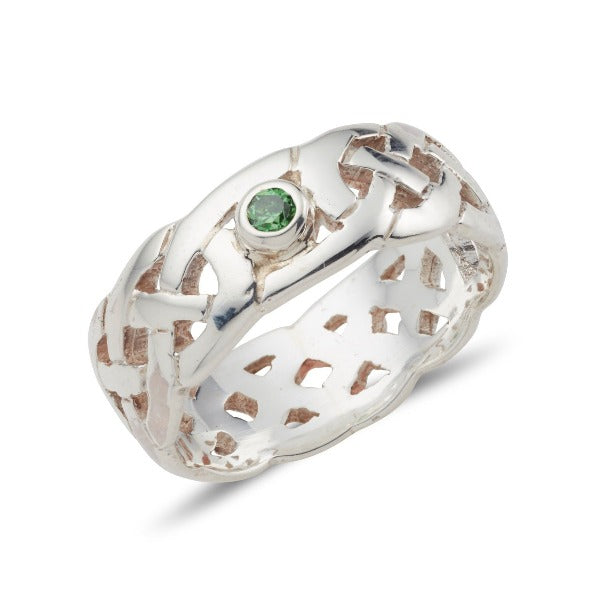sterling silver celtic design ring with a fully pierced out celtic pattern, ideal for both male an female, it is 7.5mm wide, this one has a bezel set round stone in the middle and has a green bezel set stone in the middle