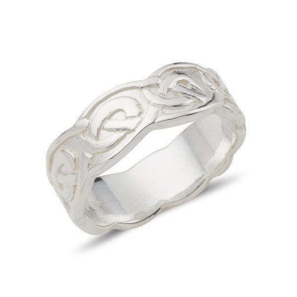 sterling silver celtic design ring with an embossed pattern and a wavy edge, this is the ladies 7mm version