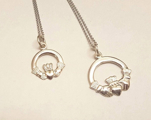 this picture shows the 2 sizes available in the classic claddagh charm necklet