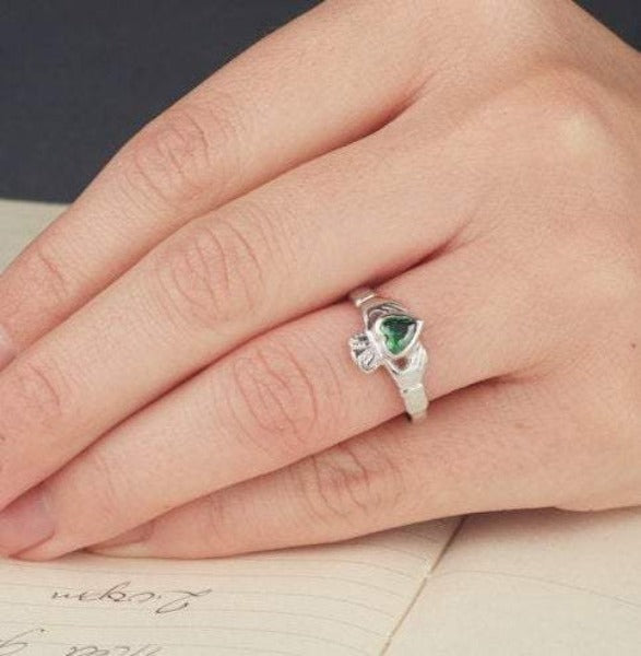 sterling silver birthstone claddagh ring as shown on a ladies hand