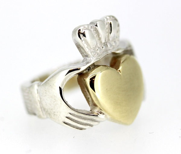 sterling silver gents heavy solid claddagh ring with gold heart view from the side to show the thickness