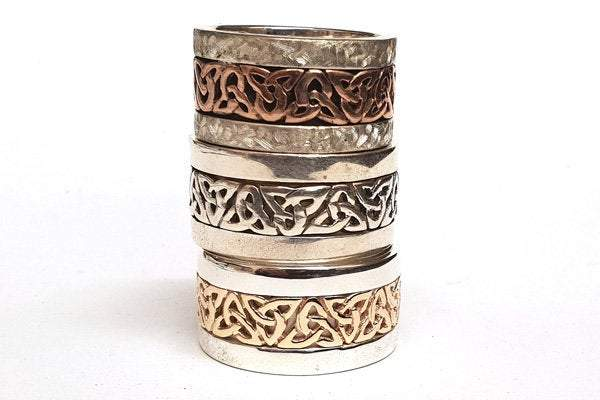 a stack of 3 large chieftan rings
