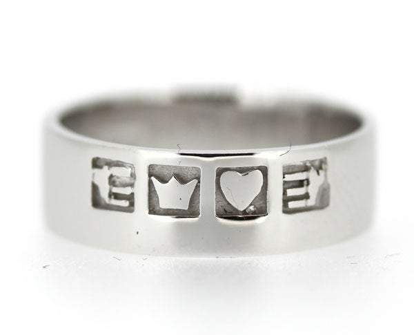 sterling silver claddagh band is 6mm in thickness with a flat profile. The symbols are split across the ring. The hands symbol for friendship, the heart for love and the crown for loyalty, the ring is oxidised behind the symbols