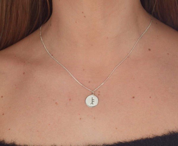 sterling silver personalised ogham pendant on chain this is a 14mm round flat disc as shown on a ladies neck