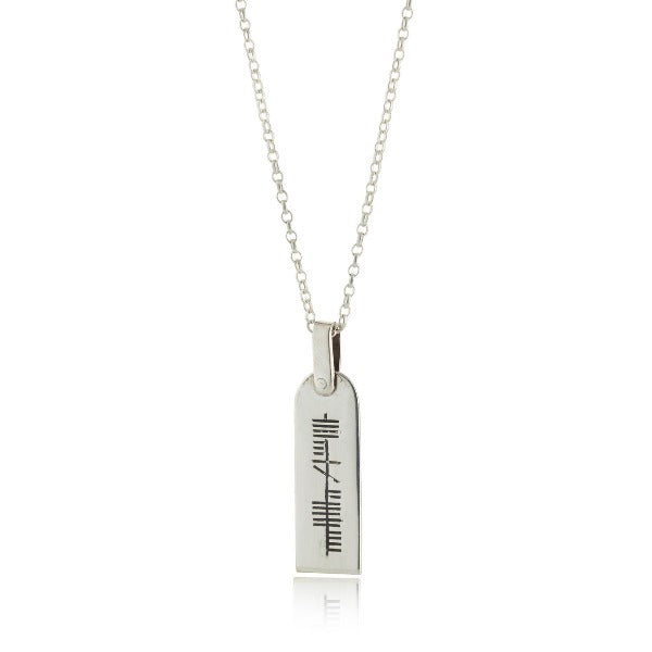 sterling silver personalised ogham pendant and chain this one is 30mm by 10mm