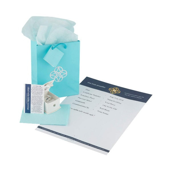 this shows the presentation a gift bag a card explaining the story of the ogham design and a bag with matching tissue,  all turquoise blue