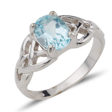 white gold twin celtic trinity triskle knot ring set with a 8mm * 6mm oval brilliant cut blue topaz within 4 claws