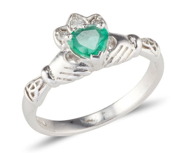white gold ladies claddagh ring with a heart shaped emerald and diamond set crown